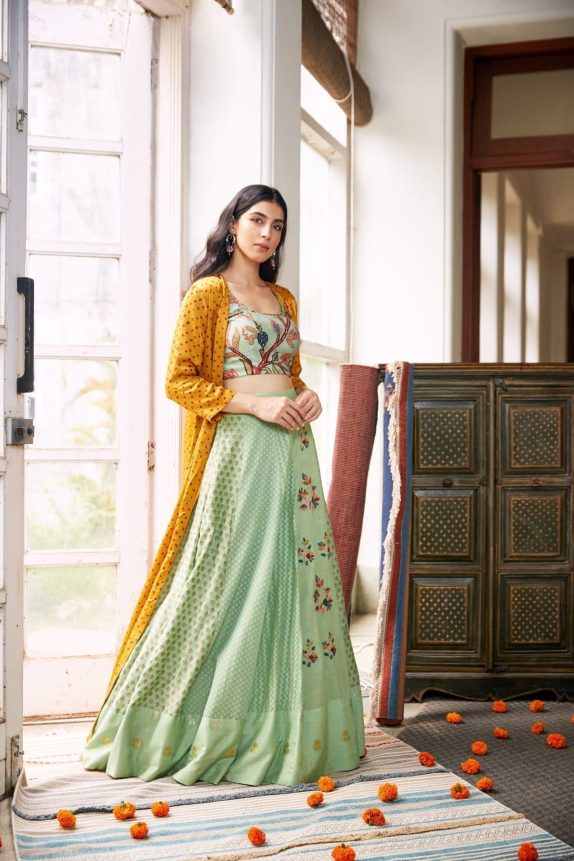 Sea Green Lehenga with a Yellow Bandhani Cape